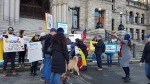 Venezuelans joined by their friends and coworkers gathered at the steps of the Legislature Wednesday afternoon in opposition to what they call Nicolas Maduro's dictatorship, Wednesday, Jan. 23, 2019. (CTV News Vancouver Island)