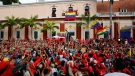 Venezuela's President Nicolas Maduro holds speaks to his supporters from a balcony at Miraflores presidential palace during a rally in Caracas, Venezuela, Wednesday, Jan. 23, 2019. (AP / Ariana Cubillos)