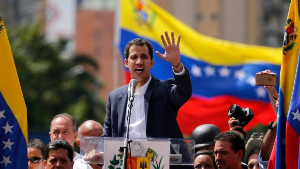 Juan Guaido, head of Venezuela's opposition-run congress, speaks to supporters at a rally where he declared himself interim president until new elections can be called in Caracas, Venezuela, Wednesday, Jan. 23, 2019. (AP / Fernando Llano)
