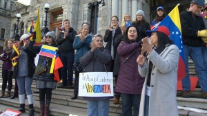 Supporters of Venzuela's new self-declared president Juan Guaido rallied on the steps of the B.C. Legislature in Victoria Wednesday, Jan. 23, 2019.