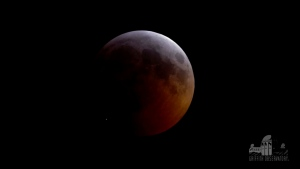 This image from video provided by Griffith Observatory in Los Angeles shows an impact flash on the moon, bottom left, during the lunar eclipse which started on Sunday evening, Jan. 20, 2019. (Griffith Observatory via AP)