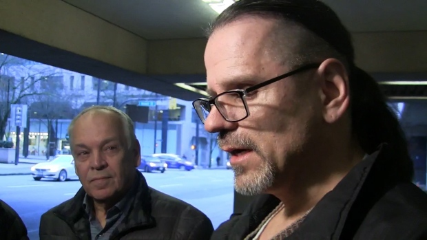 Wade Skiffington is seen speaking to reporters beside his father, Tom, left, in a still frame taken from video footage outside of court in Vancouver on Wednesday, Jan. 23, 2019. THE CANADIAN PRESS/Camille Bains