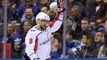 Washington Capitals left wing Alex Ovechkin (8) celebrates a goal, tying him with fellow Russian Sergei Fedorov for a career high of 50 points, during second period NHL hockey action against the Toronto Maple Leafs, in Toronto on Wednesday, Jan. 23, 2019. (THE CANADIAN PRESS/Nathan Denette)