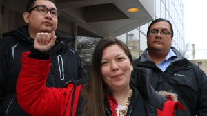 Melissa Stevenson, centre, stands outside the Winnipeg courthouse with Henry McKay, left, and Travis Bighetty after Christopher Brass was sentenced to 15 years for manslaughter in the shooting death of Stevenson's best friend, 29-year-old Jeanenne Fontaine, on Wednesday, Jan. 23, 2019. (THE CANADIAN PRESS/Kelly Malone)