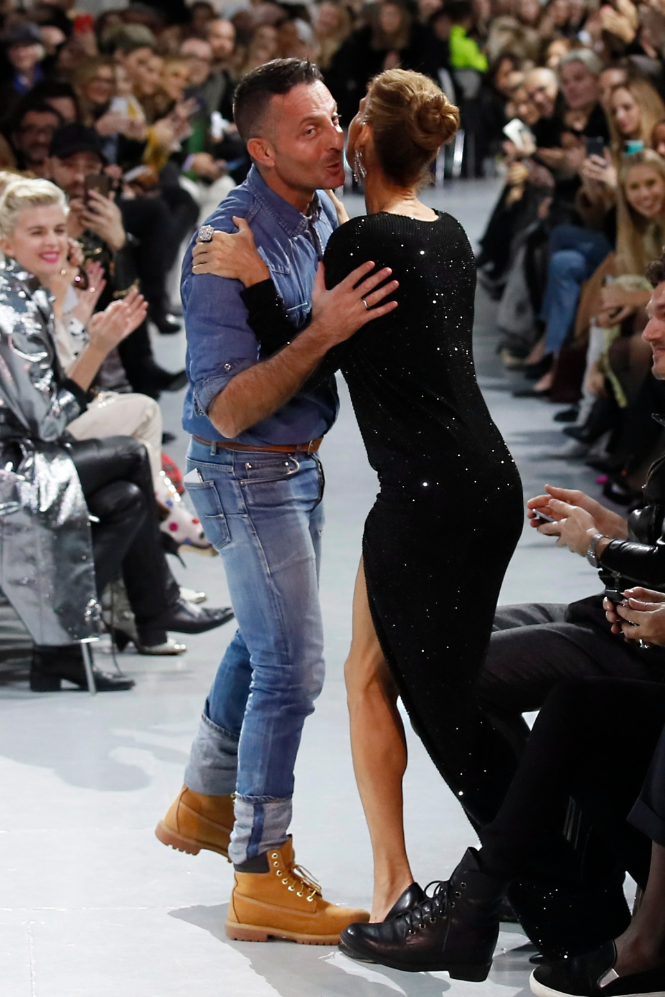 Singer Celine Dion, right, kisses designer Alexandre Vauthier after his Spring/Summer 2019 Haute Couture fashion collection presented in Paris, Tuesday Jan. 22, 2019. (AP Photo/Francois Mori)