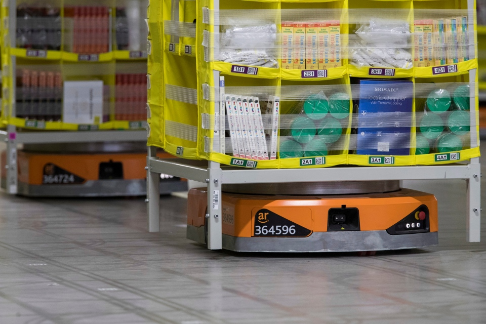 In this Dec. 5, 2018, photo pods full of merchandise are moved around the floor by robotic drives, named Amazon robots, at the Amazon fulfillment center on Staten Island borough of New York. (AP Photo/Mary Altaffer)