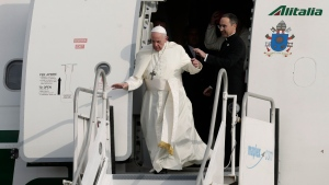 Pope Francis briefly loses his balance as he deplanes at Tocumen international airport in Panama City, Wednesday, Jan. 23, 2019. Pope Francis will be in Panama Jan. 23-27 for World Youth Day events. (AP Photo/Arnulfo Franco)