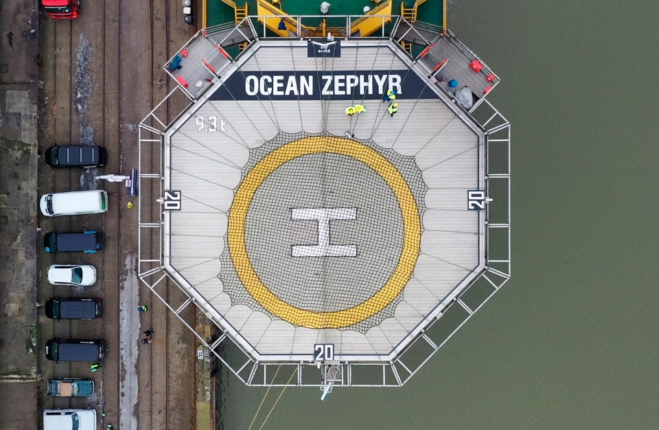 In this image taken from drone video people stand on the helipad of the Ocean Zephyr in the docks in Bremerhaven, Germany, Wednesday Jan. 23, 2019. (AP Photo/Stephen Barker)
