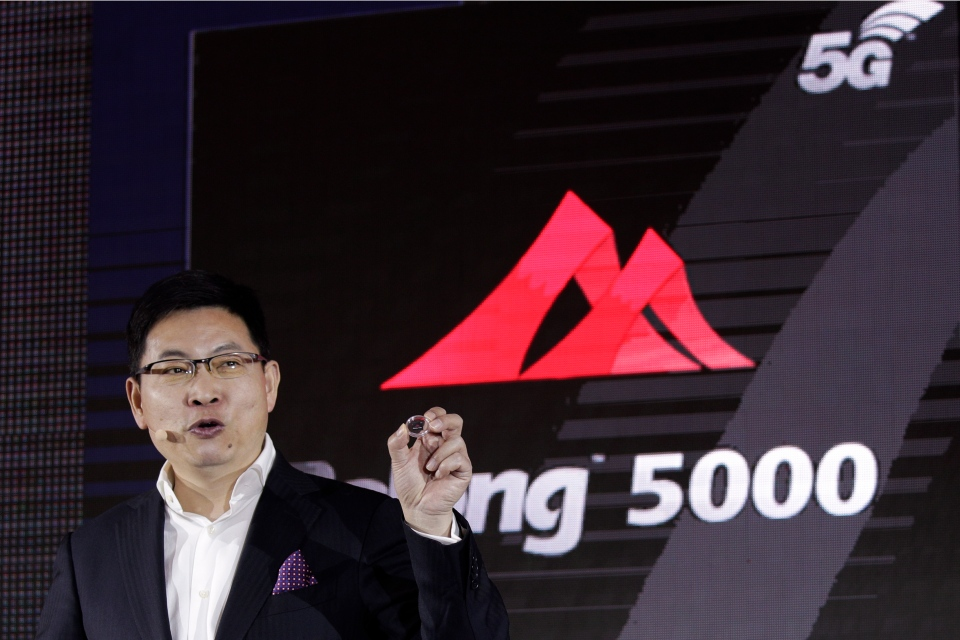 Richard Yu, CEO of Huawei Consumer Business Group speaks as he unveils the 5G modem Balong 5000 chipset in Beijing, Thursday, Jan. 24, 2019. (AP Photo/Andy Wong)