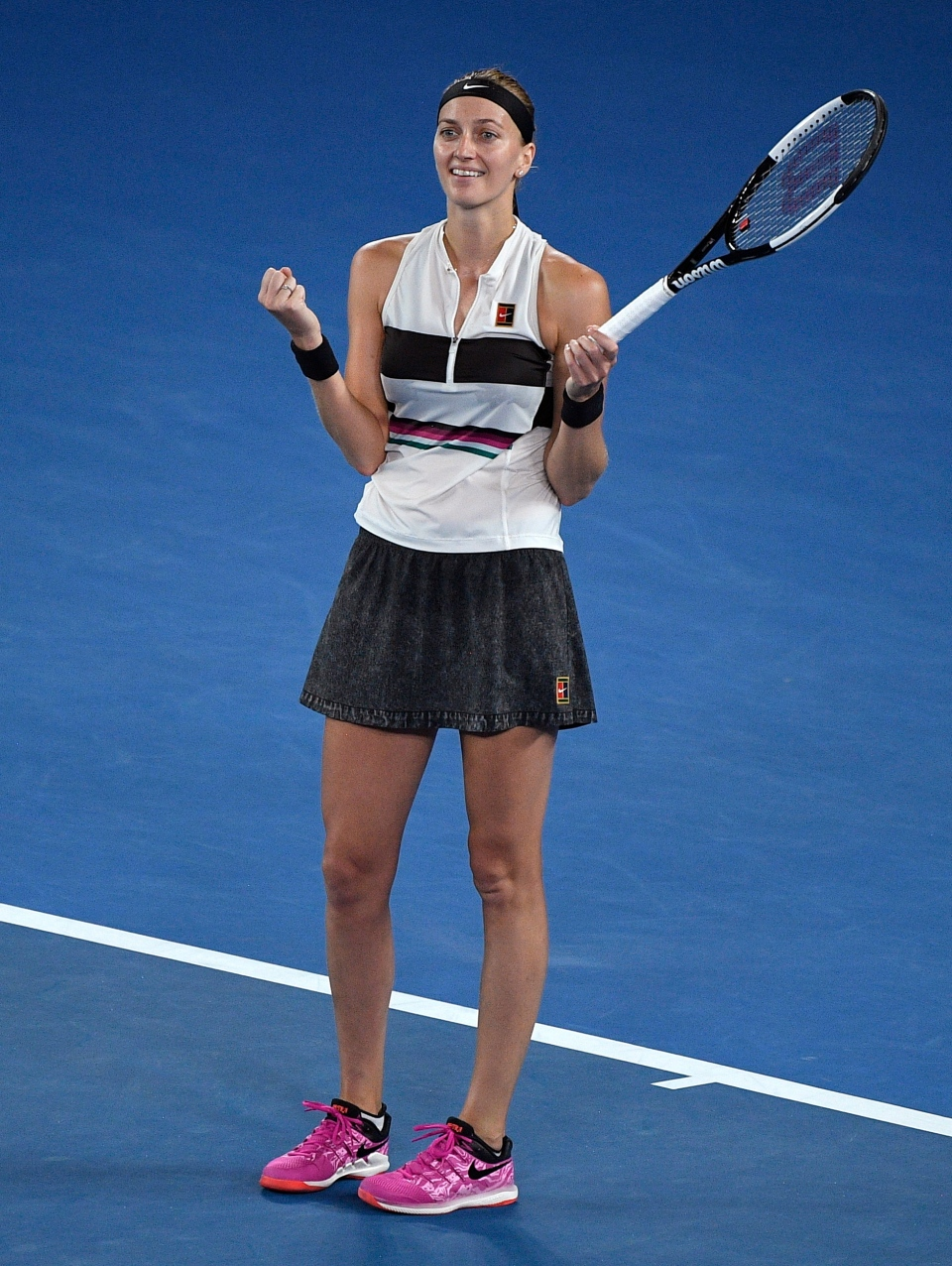 Petra Kvitova of the Czech Republic celebrates after defeating United States' Danielle Collins in their semifinal at the Australian Open tennis championships in Melbourne, Australia, Thursday, Jan. 24, 2019. (AP Photo/Andy Brownbill)