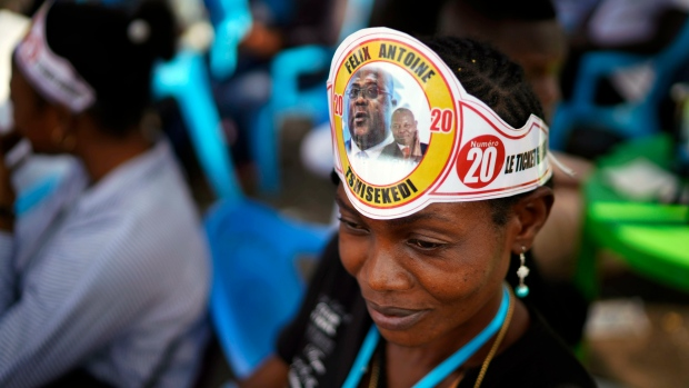 Supporters of Congolese President elect Felix Tshisekedi sell souvenirs outside his party headquarters in Kinshasa, Democratic Republic of the Congo, Wednesday Jan. 23, 2019. (AP Photo/Jerome Delay)