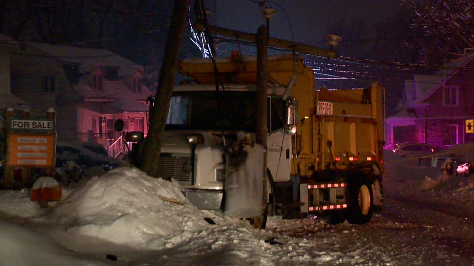 A dump truck went off the road around 1 a.m. Thursday Jan. 24, 2019 in Pierrefonds, smashing a Hydro pole. (CTV Montreal/Cosmo Santamaria)