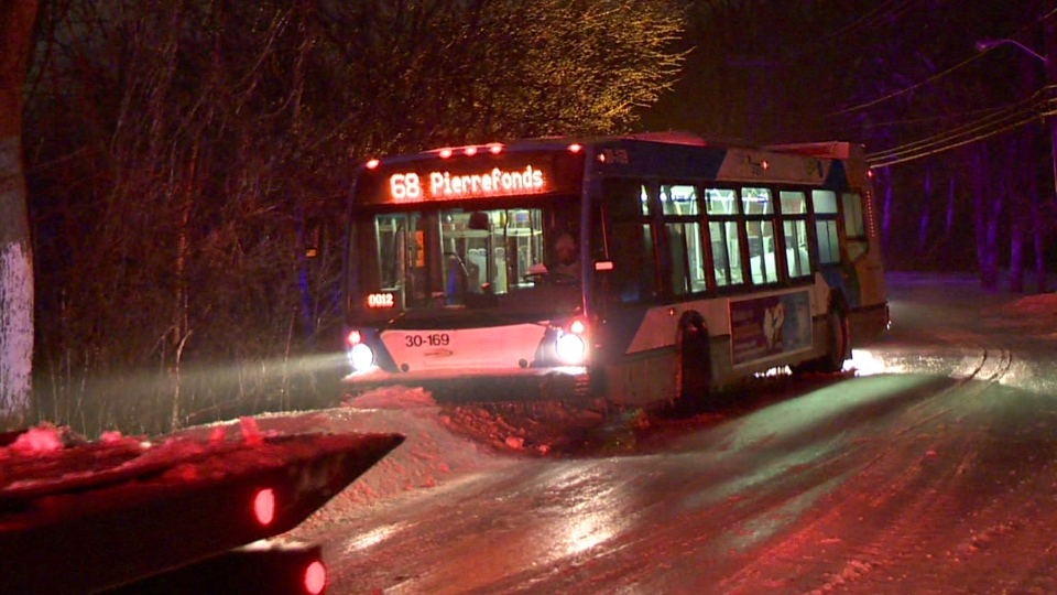 The 68 STM bus in Pierrefonds skidded off the road and had to be towed (CTV Montreal/Cosmo Santamaria)