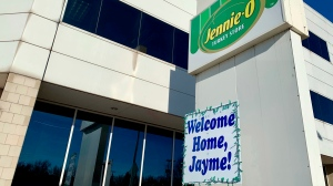 "A ""Welcome Home, Jayme!"" sign is shown Jan. 16, 2019, in front of the Jennie-O Turkey Store in Barron, Wis., where her parents, James and Denise Closs, worked. (AP Photo/Jeff Baenen)"