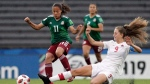 Anette Vazquez of Mexico fights for the ball with Jordyn Huitema of Canada during a 2018 FIFA U-17 Women's World Cup semifinal soccer match in Montevideo, Uruguay, Wednesday, Nov. 28, 2018. (THE CANADIAN PRESS/ AP/Matilde Campodonico)