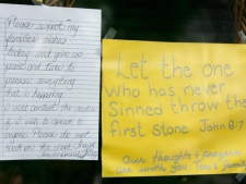 Handwritten notes hang on the door of Victoria Stafford's mother Tara McDonald's house after police confirmed the remains discovered Sunday were those of Victoria (Tori) Stafford, on Tuesday July 21, 2009. (Dave Chidley / THE CANADIAN PRESS)