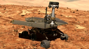 This illustration made available by NASA shows the rover Opportunity on the surface of Mars. The exploratory vehicle landed on Jan. 24, 2004, and logged more than 28 miles (45 kilometers) before falling silent during a global dust storm June 2018. There was so much dust in the Martian atmosphere that sunlight could not reach Opportunity's solar panels for power generation. (NASA via AP)
