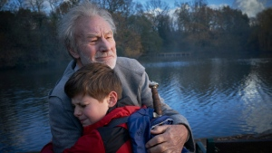 Patrick Stewart and Louis Ashbourne Serkis in 'The Kid Who Would Be King.' (Kerry Brown / 20th Century Fox via AP)