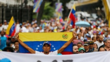 Opposition member holds a Venezuelan national flag