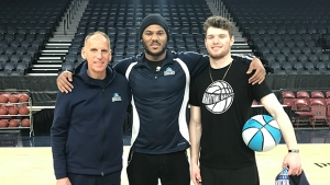 Hurricanes Hero Zak Gorman with Coach Mike Leslie and power forward Tyrone Watson.
