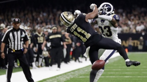 In this Sunday, Jan. 20, 2019 file photo, New Orleans Saints wide receiver Tommylee Lewis (11) works for a catch against Los Angeles Rams defensive back Nickell Robey-Coleman (23) during the second half the NFL football NFC championship game, in New Orleans. (AP Photo/Gerald Herbert, File)
