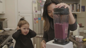 Grace Choi and her daughter Kasper enjoy making smoothies.