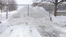 Snow piled at a south Ottawa apartment parking lot
