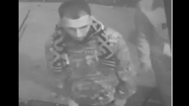 A man wanted in a shooting investigation is seen in a surveillance camera image. (TPS)