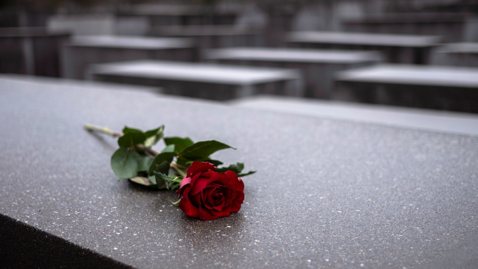A red rose lies on a slab of the Holocaust Memorial to commemorate the victims of the Nazis in Berlin, Sunday, Jan. 27, 2019. The International Holocaust Remembrance Day marks the liberation of the Auschwitz Nazi death camp on Jan. 27, 1945. (AP Photo/Markus Schreiber)