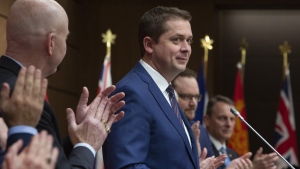 Conservative Leader Andrew Scheer receives a standing ovation as he addresses the Conservative caucus on Parliament Hill in Ottawa on Sunday, Jan. 27, 2019. THE CANADIAN PRESS/Fred Chartrand