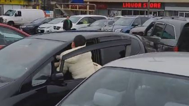 This video uploaded to YouTube by Kazumaco shows a fight in a Vancouver strip mall parking lot.