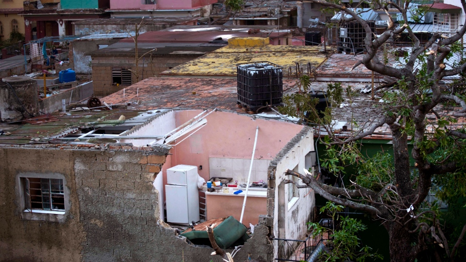 A home's kitchen is exposed after a tornado ripped the roof off in Havana, Cuba, Monday, Jan. 28, 2019. (AP Photo/Ramon Espinosa)