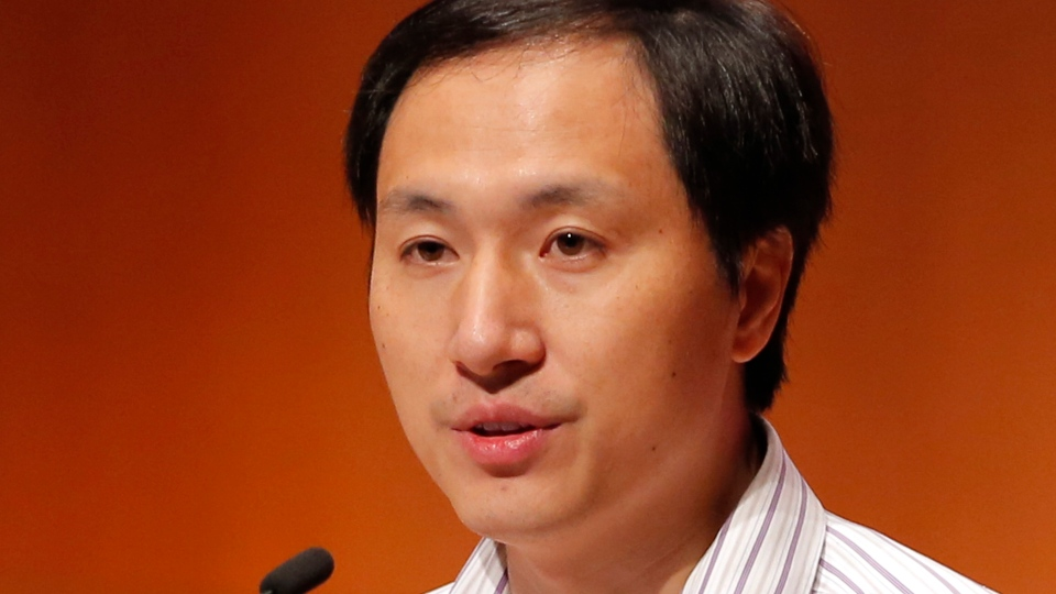 In this Nov. 28, 2018, file photo, He Jiankui, a Chinese researcher, speaks during the Human Genome Editing Conference in Hong Kong, where he made his first public comments about his claim to have helped make the world's first gene-edited babies. (AP Photo/Kin Cheung, File)