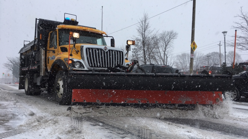 A snow plow works to clear the road in Windsor, Ont., on Monday, Jan. 28, 2019. (Chris Campbell / CTV Windsor)