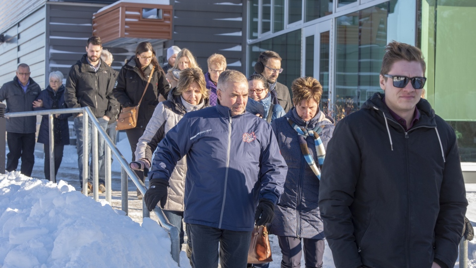 Family and friends leave for the lunch break at the sentencing hearing for Jaskirat Singh Sidhu, the driver of the truck that struck the bus carrying the Humboldt Broncos hockey team and pleaded guilty this month to 16 counts of dangerous driving causing death and 13 counts of dangerous driving causing bodily harm Monday, January 28, 2019 in Melfort, Sask. (THE CANADIAN PRESS/Ryan Remiorz)