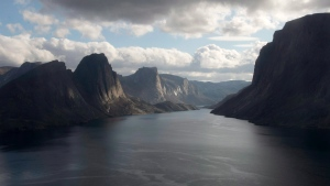 A late day sun catches mountains along the waters surrounding Baffin Island Tuesday August 26, 2014 near York Sound, Nunavut. THE CANADIAN PRESS/Adrian Wyld