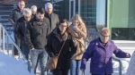 Family and friends leave for the lunch break at the sentencing hearing for Jaskirat Singh Sidhu, the driver of the truck that struck the bus carrying the Humboldt Broncos hockey team and pleaded guilty this month to 16 counts of dangerous driving causing death and 13 counts of dangerous driving causing bodily harm Monday, January 28, 2019 in Melfort, Sask. THE CANADIAN PRESS/Ryan Remiorz