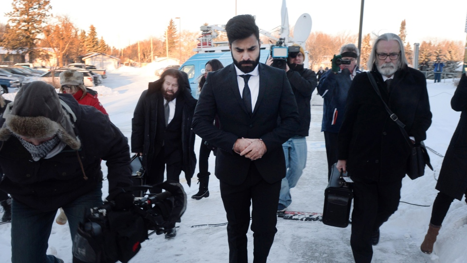 Jaskirat Singh Sidhu, centre, the driver of the truck that struck the bus carrying the Humboldt Broncos hockey team and pleaded guilty this month to 16 counts of dangerous driving causing death and 13 counts of dangerous driving causing bodily harm, arrives at a sentencing hearing, Monday, January 28, 2019 in Melfort, Sask.THE CANADIAN PRESS/Ryan Remiorz