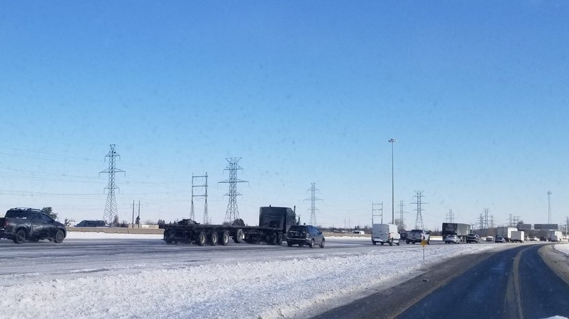 Backed-up traffic is seen on a 400-series highway near London, Ont. on Tuesday, Jan. 29, 2019. (@OPP_WR / Twitter)