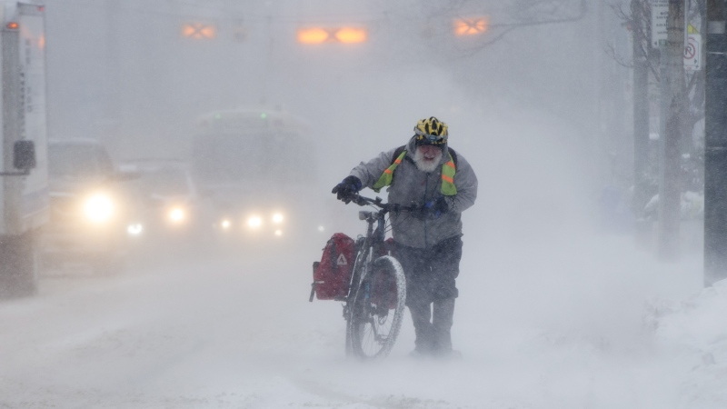 Marek Wiechula makes his way through blizzard conditions on a 15km ride in Toronto on Monday, January 28, 2019. THE CANADIAN PRESS/Frank Gunn