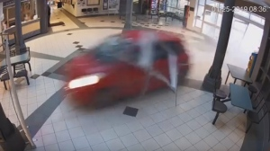 A Toyota is seen speeding through the foyer of the Courtice Community Centre on Jan. 25, 2019. (Durham Regional Police Service)