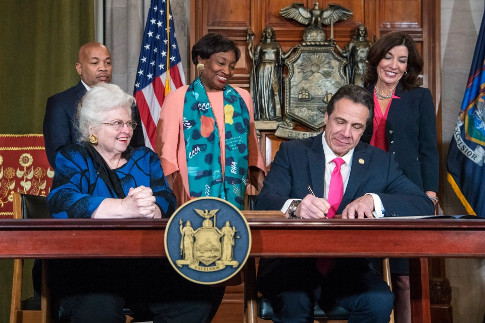 In this photo provided by the Office of Gov. Andrew M. Cuomo, Cuomo, right, signs Reproductive Health Act Legislation during a ceremony, Tuesday, Jan. 22, 2019, in the Red Room at the State Capitol in Albany, N.Y. With the new law, New York state enacts one of the nation's strongest protections for abortion rights, a move that state leaders say was needed to safeguard those rights should the U.S. Supreme Court overturn Roe v. Wade. Also pictured are attorney Sarah Weddington, front left, who successfully argued Roe v Wade before the Supreme Court; New York State assembly Speaker Carl Heastie, back left; New York State Senate Leader Andrea Stewart-Cousins, D-Yonkers, standing center; and Democratic Lt. Gov Kathy Hochul, back right. (Darren McGee/Office of Gov. Andrew M. Cuomo via AP)
