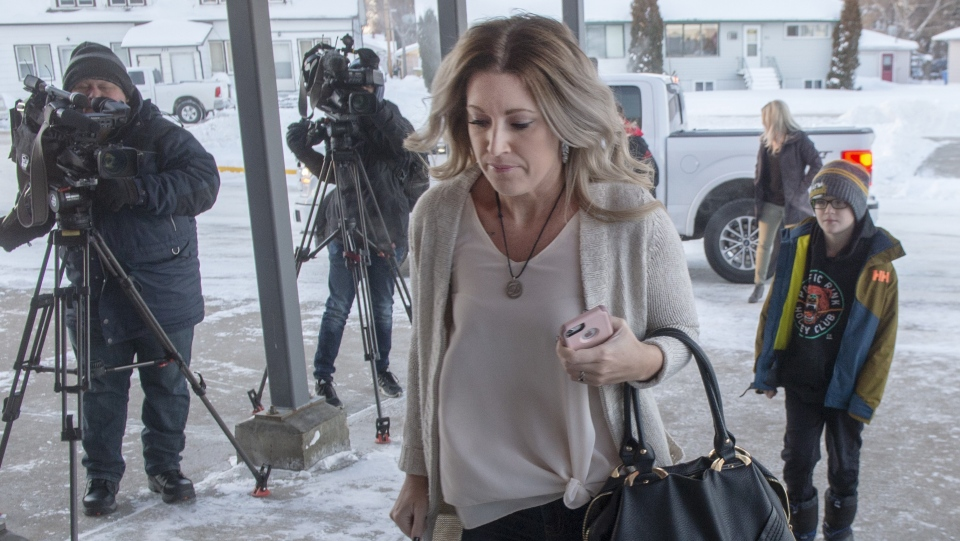 Christina Haugan, wife of coach Darcy Haugan who died in the Humboldt hockey team bus crash, and her son, Jackson, arrive for the second day of sentencing hearing for truck driver Jaskirat Singh Sidhu, Tuesday, January 29, 2019 in Melfort, Sask. (THE CANADIAN PRESS/Ryan Remiorz)