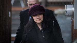 Huawei chief financial officer Meng Wanzhou, who is out on bail and remains under partial house arrest after she was detained Dec. 1 at the behest of American authorities, leaves her home to attend a court appearance regarding her bail conditions, in Vancouver, on Tuesday January 29, 2019. THE CANADIAN PRESS/Darryl Dyck