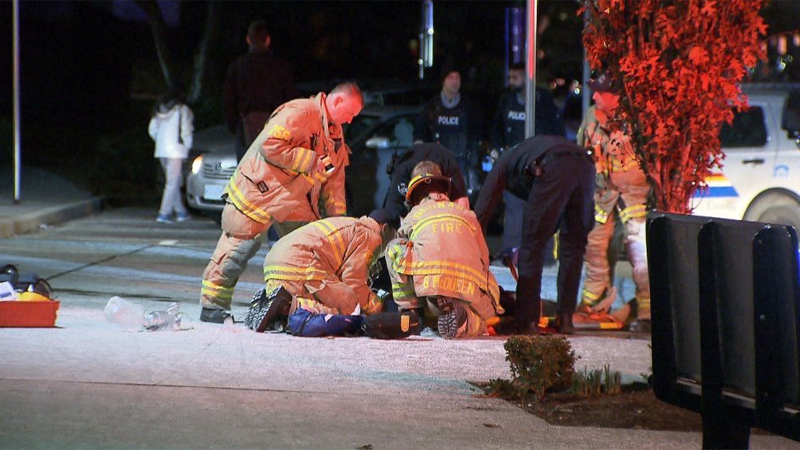 Firefighters perform first aid after a reported stabbing near the Royal Oak SkyTrain Station in Burnaby. Jan. 29, 2019.