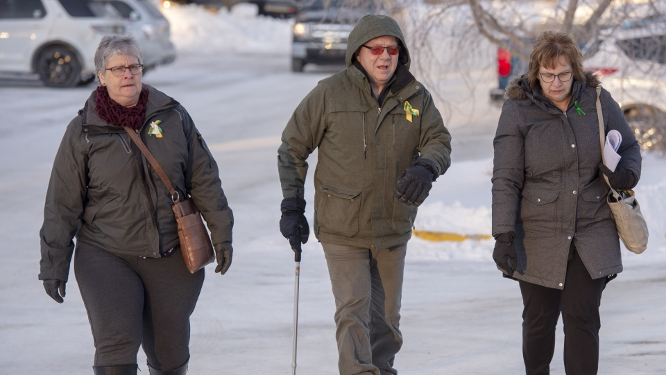 Lyle Brons, centre, and his wife Carol, right, whose daughter Dayna, the team's athletic therapist, was killed in the crash arrive for the third day of sentencing hearings for Jaskirat Singh Sidhu, the driver of the truck that struck the bus carrying the Humboldt Broncos hockey team arrives in Melfort, Sask., Wednesday, Jan. 30, 2019. (THE CANADIAN PRESS/Ryan Remiorz)