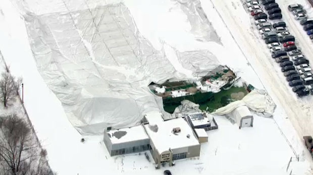 In aerial footage of the Metro Golf Dome, the typically inflated structure appears to be completely flattened.