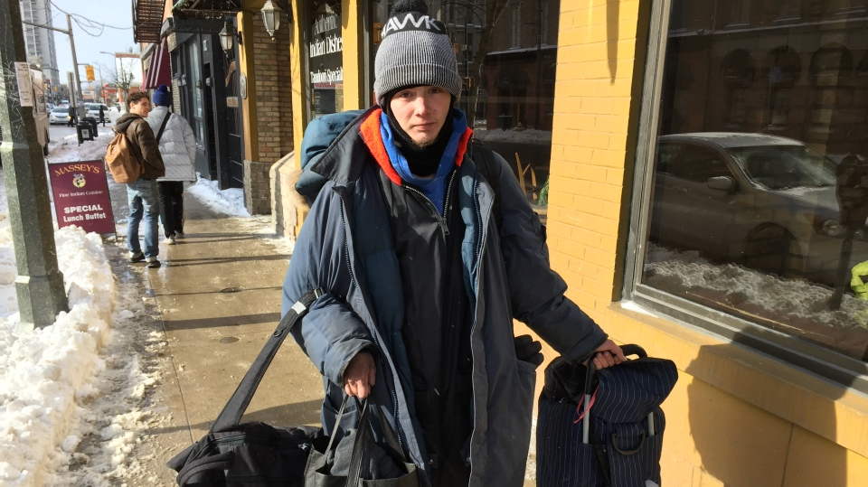 Devin Morris, 25, who is homeless and has been on the waitlist for social housing for three years, carries his belongings in London, Ont. on Wednesday, Jan. 30, 2019. (Bryan Bicknell / CTV London)