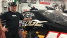 DJ Kennington stands next to his racecar in St. Thomas, Ont. on Wednesday, Jan. 30, 2019. (Brent Lale / CTV London)