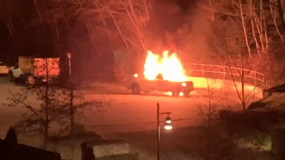 Social media video shows a truck burning shortly after a stabbing that left an 18-year-old man in hospital Tuesday night in Burnaby. (Twitter/WestCoastFrank)